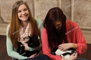 Taking a photo with the felines is never easy