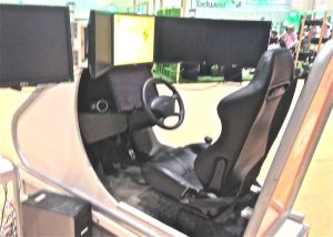 Driving simulator. Though some of the girls play video games, it's obvious they don't have driver's licenses.